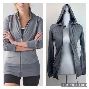 Lululemon daily practice light long heather gray hooded jacket 2 tiny holes.